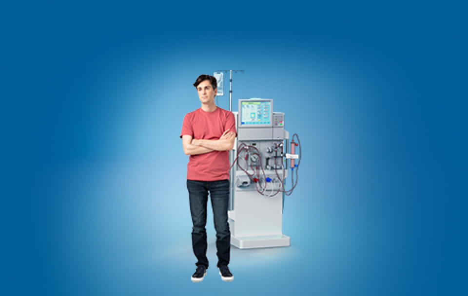 Adult Standing Next To Dialysis Machine